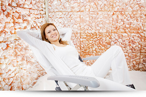 girl smiling salt room START A SALT THERAPY BUSINESS
