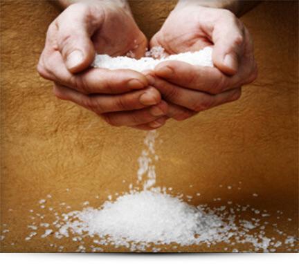 hands holding salt shadow START A SALT THERAPY BUSINESS